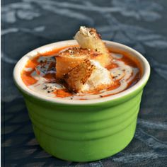 Smoky spicy tomato soup made with roasted vegetables. Topped with smoked sea salt  black pepper sourdough croutons.