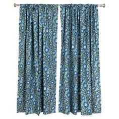 "Featuring flowers and vines in a brilliant palette, this pair of cotton curtains dresses your window in beaming style.   Product: Set of 2 curtain panelsConstruction Material: CottonColor:  BlueFeatures:  2"" Rod pocket3"" HemMade in the USA  Note: Rod not includedCleaning and Care: Spot clean"