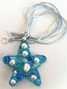 a star pendant with wire, beads and random leftovers crystals. #DIY #wire #jewelry #beads #crystals #pearls #star #tutorial #pendant