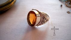 """12 carat Golden Citrine & 925 SOLID STERLING SILVER ring, size 6. Item is stamped 925 .dimension of the face of the ring is aprox 2/3"""" long & 1/2"""" inches wide. This ring is made out of original victorian mould from victorian era with intricate design . Victorian / Steampunk in design!"""