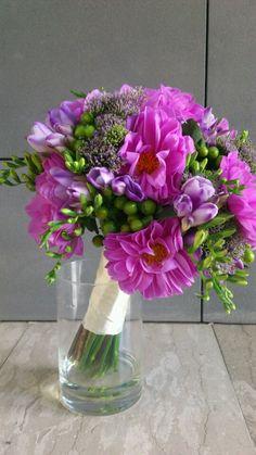 Purple bridal bouquet with Dahlias, freesias, Trachelium and green hipericum berries