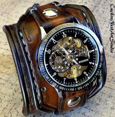 Men's aged brown color steampunk leather watch cuff made with veg tanned leather, completely handmade, hand tooled, hand stitched with natural thread. …