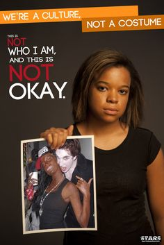 A young, unsmiling black woman holds up a picture of a white woman in black face at a Halloween party. ATTENTION WHITE PEOPLE: blackface is NEVER ok for you. Period.