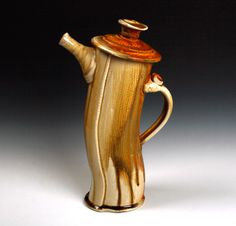 Extruded teapot! http://www.stonethrownstudio.com/ This is Tom Hubbell...I have several pieces. He's and incredible potter!
