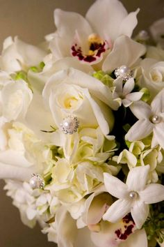 Love the pearls and crystals in this bouquet! Flowers: stephanotis, roses, hydrangeas and seeded eucalyptus.