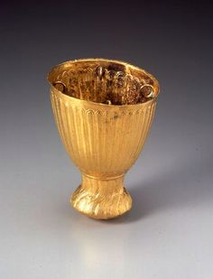 Achaemenid Gold Censer  Gold, 5th-4th century B.C.E. H. 9.8 cm.   This high-footed cup form is thought to originally have been a censer. The foot with its rounded bottom is incised from the center of the base with a radiating pattern of thin lines which rise up the sides of the foot.