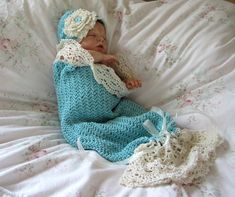 This crochet pattern is for a gorgeous lace trimmed snuggle sack. The matching hat has a beautiful frilly Irish Rose. This is a heirloom quality