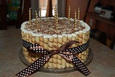 Coffee and chocolate flavored birthday cake with golden candles and brown ribbon.JPG