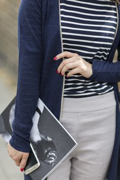 Park and Cube wears a navy striped Boden Breton top, grey trousers and black penny loafers. June 2015.