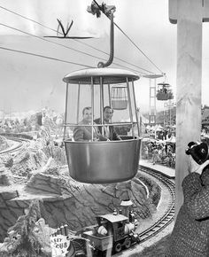Walt Disney on the inaugural voyage of the Skyway.