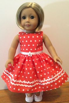 This 1950's inspired dress will look great on any doll. It has a detachable belt and Velcro back closure.