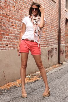Pink or coral shorts, a brown belt, white shirt, pattern scarf, and neutral wedges. And you have a complete, summer, chic outfit my little chick-a-dees!