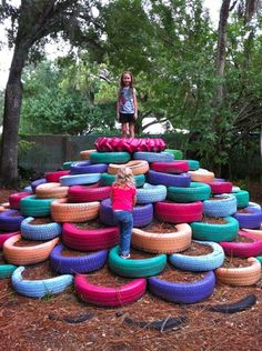 Reused tires make a great place to climb. diy you can fin these in alot of places look up on google where you can pick them up in your area have the kids paint them and there you have it make sure you pack them down with mulch!!!! <3 so much fun i might make a smaller one for a ( 2 year old)