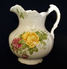 Small+Floral+Pitcher+-+Buffalo+Pottery+-+AntiqueSimilar to mine but smaler only yellow roses.