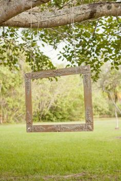 What a neat idea. Hang an old frame from a tree and then take family pictures.