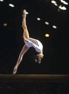 1976 Summer Olympics: gold medalist gymnast Nadia Comaneci of Romania in action on balance beam at the Montreal Forum. Gymnastics History, Gymnastics Events, Gymnastics Competition, Artistic Gymnastics, Olympic Gymnastics, Olympic Games, 1976 Olympics, Summer Olympics, Nadia Comaneci 1976