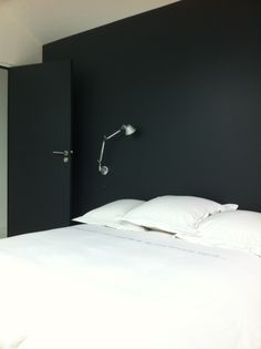 Bedroom black wall white simple