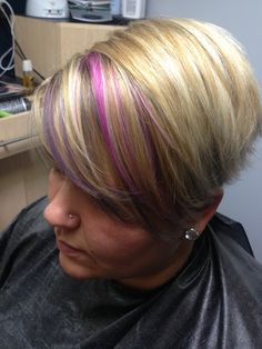 Hot pink and purple strands on baby blonde highlights, long pixie cut
