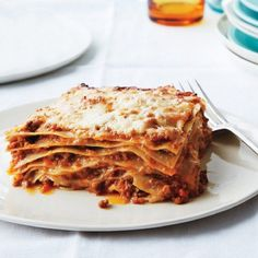 Maybe you're not a nonna. And you didn't inherit a faded recipe for lasagna Bolognese from one, either. Not to worry. What matters is that this version of the Italian classic tastes as though it's been perfected over generations. The dish's complex sauce, rich béchamel, and—here's the secret—eight impossibly thin pasta layers (yes, homemade) create a bril...