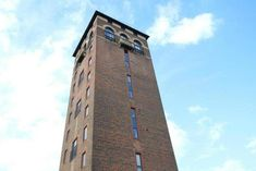 Live the high life: quirky flat on the top floors of a converted water tower has listed for sale in Hertfordshire Unusual Buildings, Unusual Homes, Water Tower, Medieval Castle, Flats For Sale, Windmill, Countryside, Britain, Floors