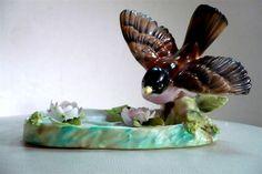 Porcelain robin in bird bath