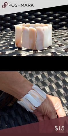 Pretty Handmade Bracelet Pretty handmade bracelet.  Has stretch/elastic.  Perfect for summer!  *for reference (pic 2)- I have tiny wrists (5.5 circumference)( Jewelry Bracelets
