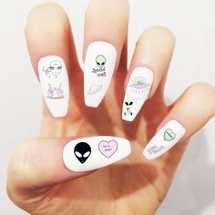 Get out of this world with our Alien Nail Decal Set featuring a variety of alien and word illustrations, now available on Etsy! #LunaMoon
