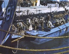 """Local Identifier: 111-SC-1237, """"American troops at a British port descend into barges which will take them to troop ships from which they will launch the attack against Hitler's Fortress Europe."""" (US National Archives)"""