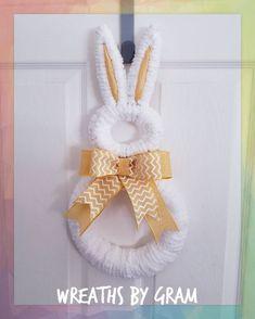 Yarn Bunny wreath; Easter wreath; easter decorations farmhouse mantle; easter decor ideas for the home; Farmhouse easter decor; spring wreaths ideas; easter gift ideas for moms; easter time decoration crafts; bunny door hanger; bunny decor ideas; easter door hanger; bunny rescue; here comes peter cottontail; peter cottontail nursery decor; bunny nursery theme #easter #petercottontail #easterbunny #bunnynurserydecor Spring Wreaths, Easter Wreaths, Yarn Wreaths, Easter Bunny Decorations, Easter Decor, Easter Party, Easter Gift, Bunny Rescue, Easter Holidays