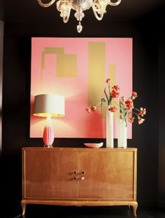 love the painting hanging over this credenza