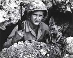 Private John L. Drugan and his dog Pal on Okinawa, May 1945. Pal saved a platoon of Marines from an ambush by alerting his handler of a hidden Japanese machine gun nest.