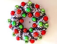 Tinsel Wreath - I like this idea, but with different colors.  Maybe Pink and black ornaments with the polka dots on a white or black wreath for a girl's room?