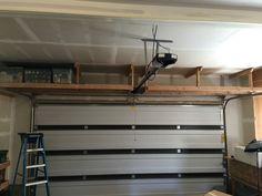 2 x 4 garage storage. 2 x 4 over-garage-door storage Diy Overhead Garage Storage, Hanging Garage Shelves, Garage Storage Shelves, Garage Storage Solutions, Door Storage, Garage Organization, Storage Ideas, Rv Storage, Organizing