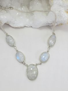 Handmade 925-hallmarked sterling silver necklace has 5 oval Rainbow Moonstone gemstones with generous chatoyance. Pairs nicely with our selection of matching bracelets, available separately. Length: 1