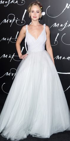 Jennifer Lawrence stunned at the premiere of her latest film Mother! in New York City. The star donned a tulle gown worthy of a fairytale princess and opted out of jewelry, going for flowers in her hair instead.