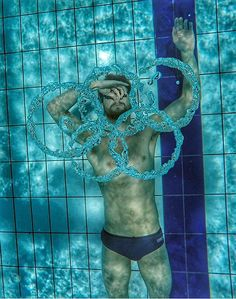 Bubble rings: A Russian swimmer blows the Olympic rings under the water at the pool...