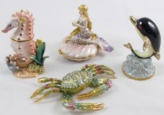 Found on EstateSales.NET: Swarovski Crystal Sea Horse Trinket Box, Enamel Brass CZ Crystal Crab Trinket Box, Mermaid Enamel Swarovski Crystal Trinket Box, Dolphin Swarovski Crystal Trinket Box