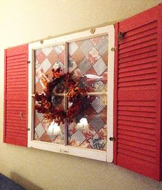 Who can resist red shutters? The red toile in the quilt behind it matches the red toile in my kitchen. The blue matches the couch this window hangs over. I think this one is my favorite. Shhhh...don't tell the others.