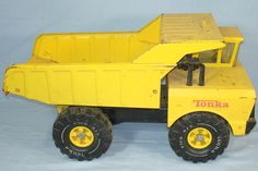 All metal Tonka Dump Truck w/pneumatic bed.  This ting was so tough I could sit in it or later ride it like it was a skateboard.