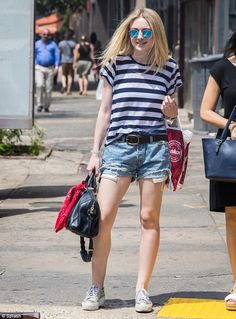 Pins on parade: Dakota Fanning kept it casual as she showed off her toned legs in a pair of cut-off denim shirts as she soaked up the sun New York on Wednesday