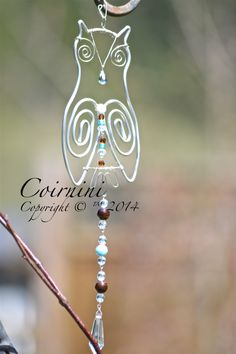 Whoo wouldn't love this beautiful Owl Suncatcher? Hand made with silver wire, aqua and brown glass beads and a gorgeous vintage glass prism. Of course they would look even more beautiful hanging in your window. https://www.facebook.com/photo.php?fbid=290811331074276set=a.184098301745580.1073741896.160531907435553type=1theater
