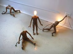 Headlight by Brooklyn-based sculptor Stephen Shaheen :: Miniature Lightbulb People Seek Life from Power Outlets