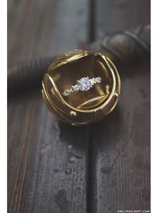 Harry Potter wedding ideas for book lovers - a golden snitch ring box