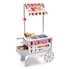 Let your little one's imagination run wild with the Melissa & Doug Snacks & Sweets Food Cart. This wooden food cart provides a variety of play scenarios: hot dog stand, ice-cream cart or mobile market with over 40 play pieces. Ice Cream Stand, Ice Cream Cart, Wooden Cart, Wooden Food, Toys For Girls, Kids Toys, Play Food Set, Play Sets, Soft Pretzels