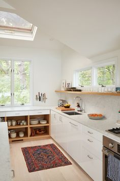 Lisa Jones' Shelter Island House Kitchen Closeup, Photo by Jonathan Hokklo IKEA ringhult cabinets with customised oak cabinetry