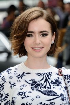 Lily Collins attending Chanel's Fall-Winter 2014/2015 Haute Couture collection show held at the Grand Palais in Paris, France, on July 08, 2014.