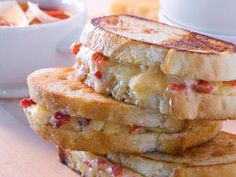 Not your mama's grilled cheese sandwich! This comfort food classic redo features the contemporary flavor appeal of white Cheddar cheese and rich roasted red peppers in a simple quick-to-fix grilled cheese sandwich recipe loaded with flavor.
