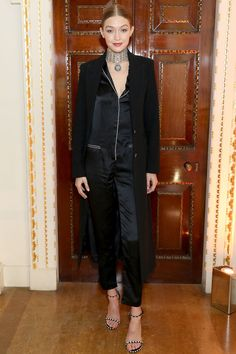 Gigi Hadid hosted a dinner to celebrate the opening of the Stuart Weitzman London store wearing a silky pyjama-inspired ensemble and plenty of jewellery. More celebrity style inspiration here: http://www.harpersbazaar.co.uk/fashion/style-files/news/g37370/best-dressed-this-week-14-november/