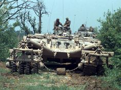 M60 Main battle tank with mine rollers