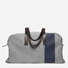 """The Twill Weekender - Everlane - reverse denim navy stripe - 22"""" L X 8.5"""" W X 12"""" H; 12"""" shoulder drop Fits inside any overhead compartment; 100% water-resistant non-slub cotton twill exterior, leather straps and gunmetal feet Spot clean only"""